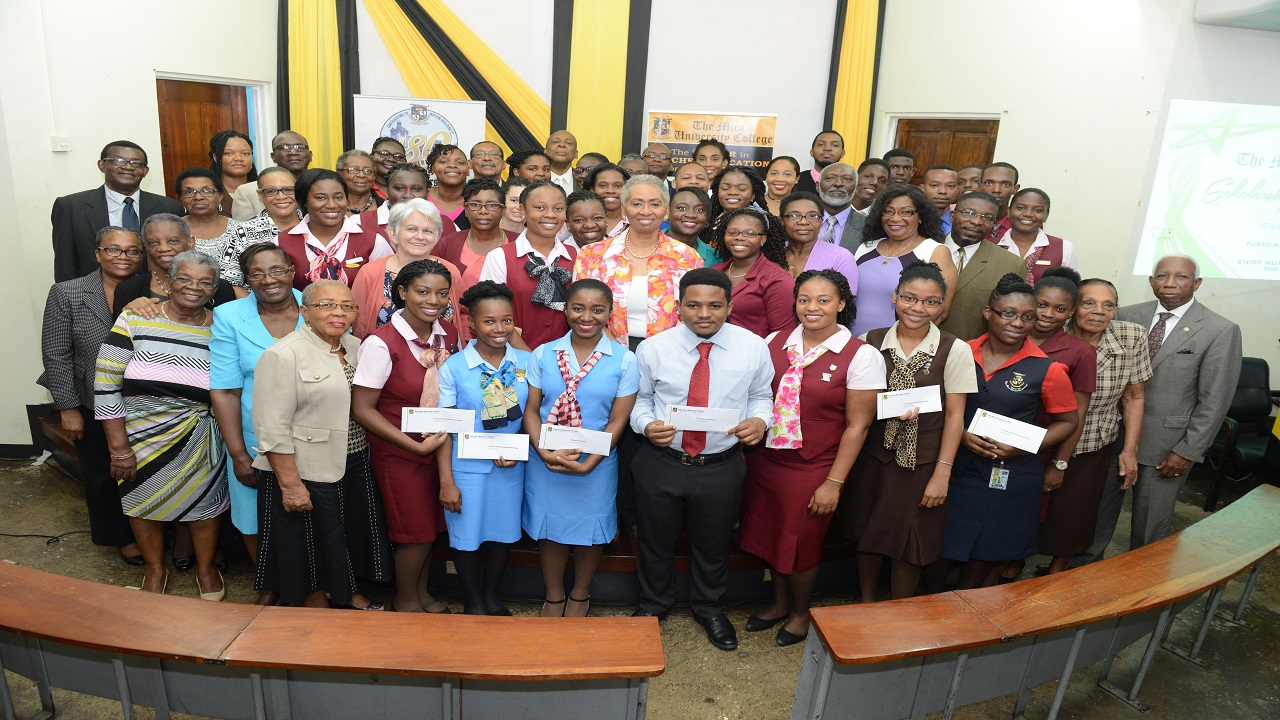 File photo of scholarship recipients of 2017 from the Mico University College in 2017 pose with academic staff and donors.