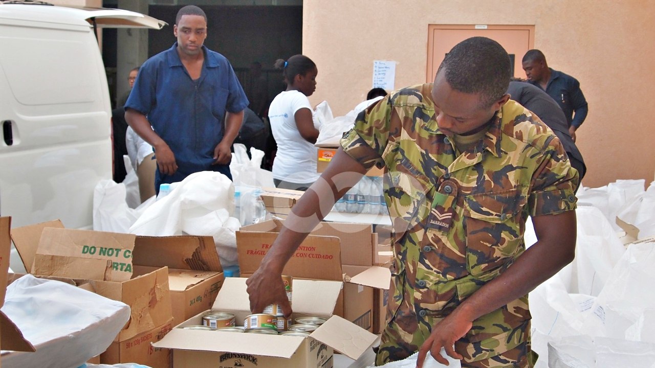 FILE - Relief supplies being prepared for Dominica at CDEMA headquarters in Barbados.
