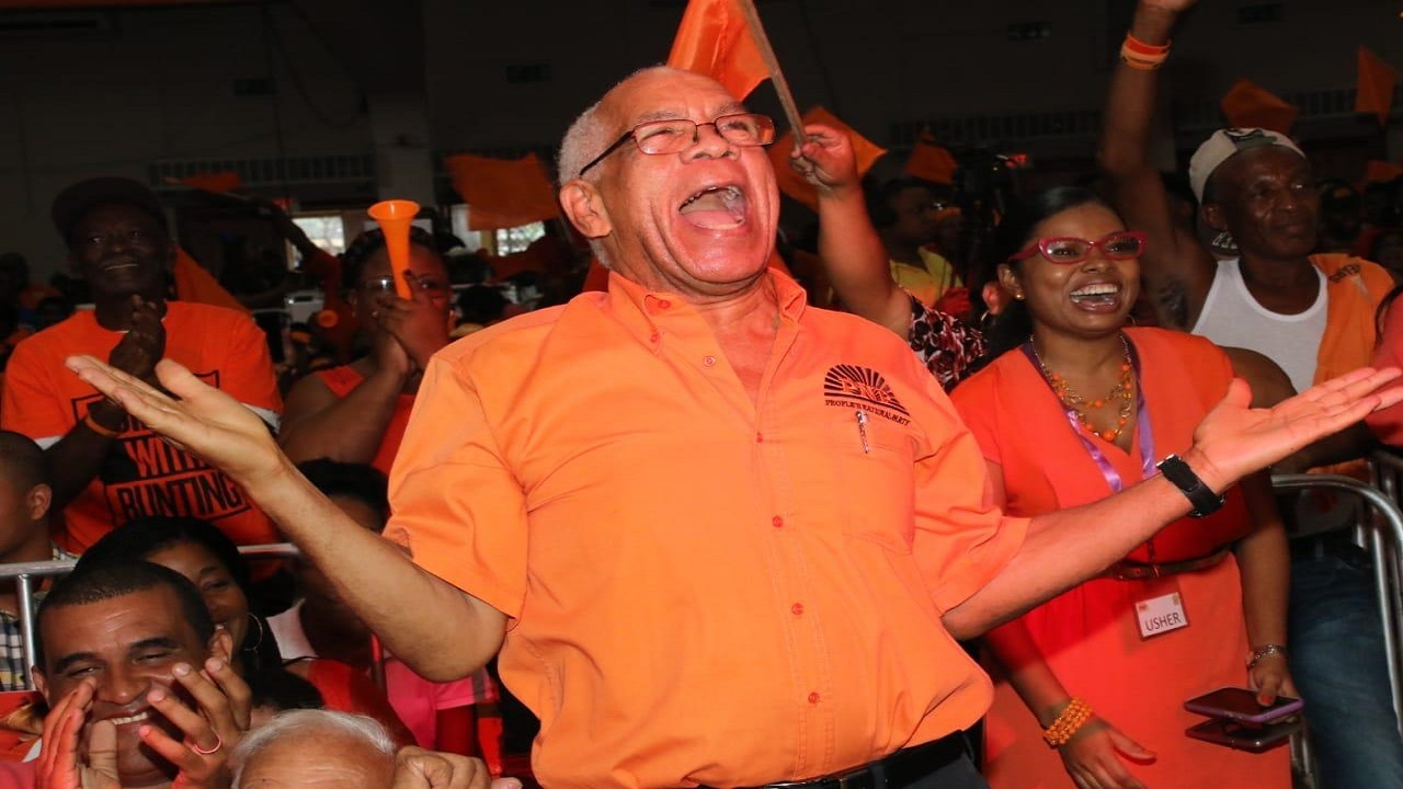 PNP elder statesman, Dr Omar Davies in extremely high spirits at the party's 80th annual conference on Sunday.