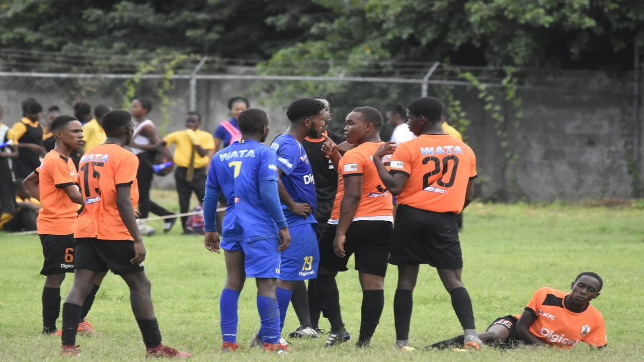 Denham Town and Tivoli players in a heated discussion during their Digicel Manning Cup encounter on Monday. (PHOTOS: Marlon Reid)