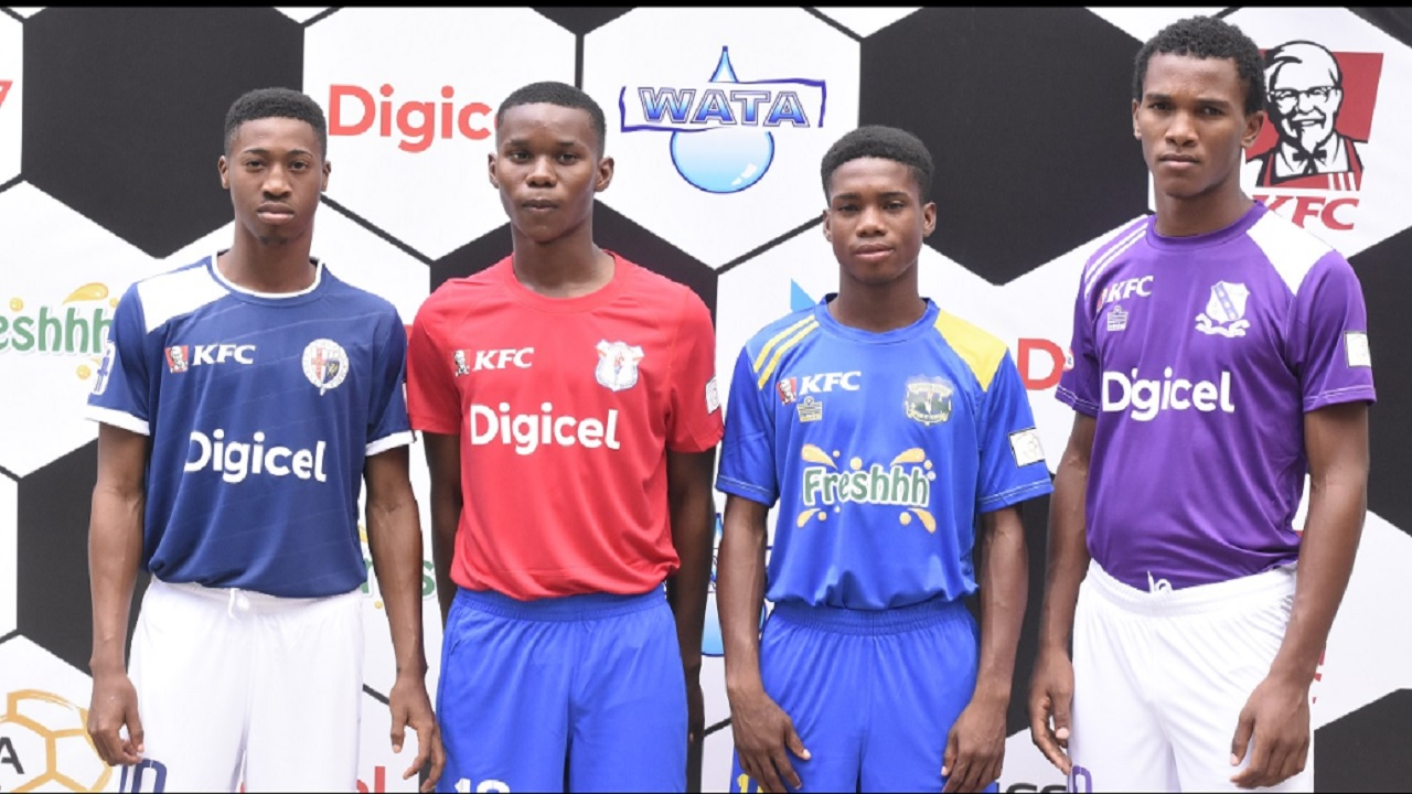 Players display kits for schools at the launch of the 2018 schoolboy football season at the Terra Nova hotel in St Andrew on August 22. Digicel will invest $75 million over three years as title sponsors for the urban area Manning Cup and Walker Cup knockout competitions. Wisynco announced a sponsorship package of close to $100 million for the rural area daCosta Cup and Ben Francis knockout competitions. (Photo: Marlon Reid).