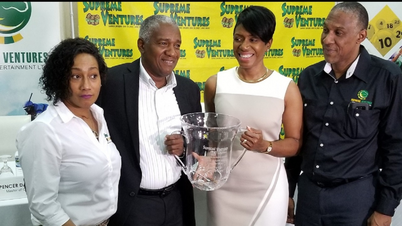Heather Goldson, SVL Chief Marketing Officer; Michael Bernard, SVREL Chairman; Ann Dawn Young-Sang, SVL CEO; and Peter Green, SVREL Director of Marketing with the SVL Jamaica Two-Year-Old Series Trophy at the launch of the series at the Spanish Court Hotel in Kingston on Thursday.