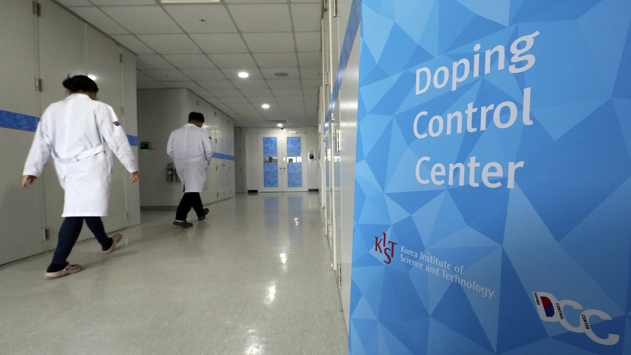In this Feb. 19, 2018, file photo, researches enter into the Doping Control Center at the Korea Institute of Science and Technology in Seoul, South Korea. A majority of U.S. athletes responding to an anti-doping survey said they feel pressure from higher-ups to win medals, and the spotlight shines only on those who pile up victories.