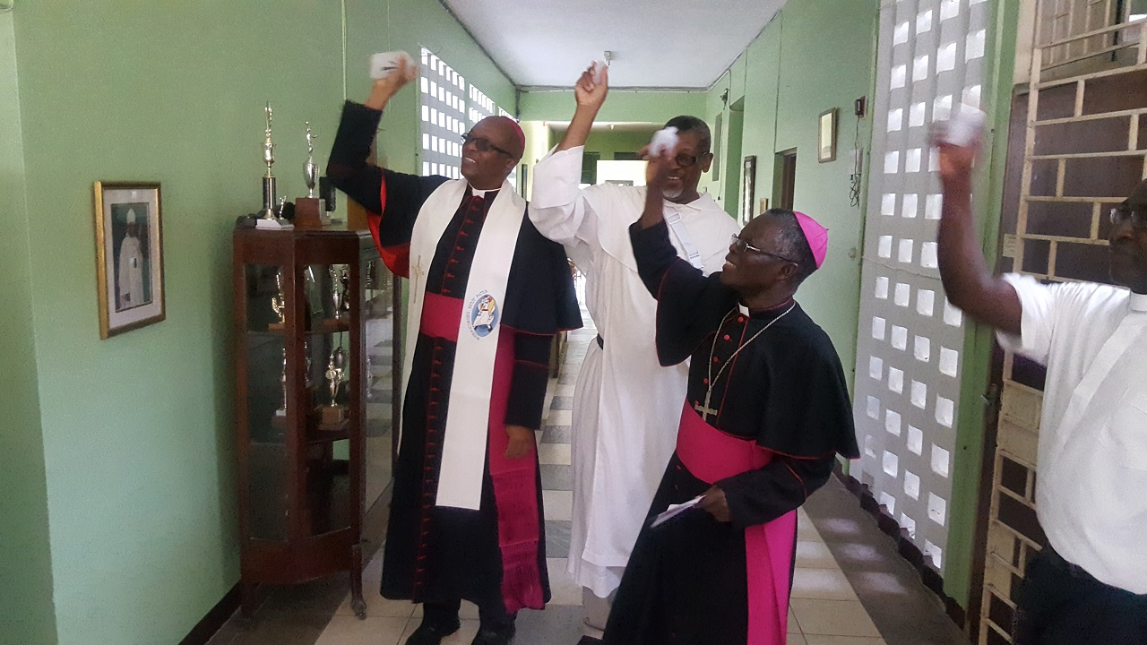 Archbishop of Kingston Kenneth Richards (left) and other Catholic church leaders bless the new facility. (PHOTOS: Marlon Reid)