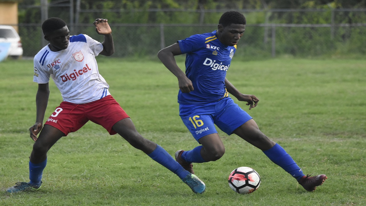 Kavaughn Hyman of Ardenne High dribbles away from Clan Carthy High Kereffe Boswell during their rescheduled ISSA/Digicel Manning Cup Group B game at Ardenne on Thursday, September 27, 2018. Clan Carthy won 2-1. (PHOTOS: Marlon Reid).