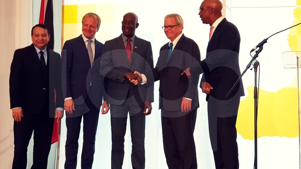 Photo L-R: Energy Minister Franklin Khan, Shell's director of Integrated Gas and New Energies, Maarten Wetselaar, Prime Minister Dr Keith Rowley, Shell Chairman Charles Holliday, and Vice Chair and Country Chair of Shell Trinidad and Tobago, Derek Hudson. Photo by Alina Doodnath.