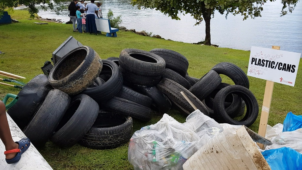 Photo: A tractor tyre and over a thousand plastic drinking bottles were collected at the Foreshore, off Audrey Jeffers Highway, during a beach clean-up on September 16, 2018. Photo courtesy Alina Doodnath.