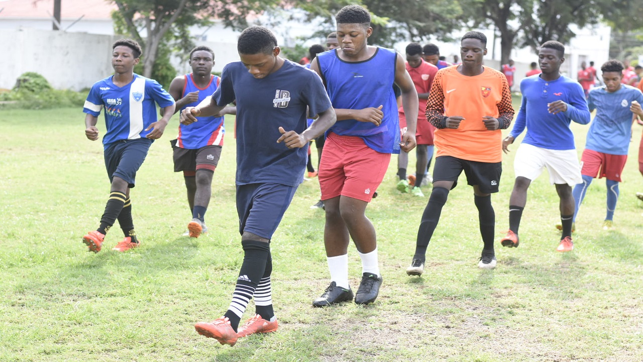 Members of Holy Trinity High football squad at a recent training session. (PHOTOS: Marlon Reid)