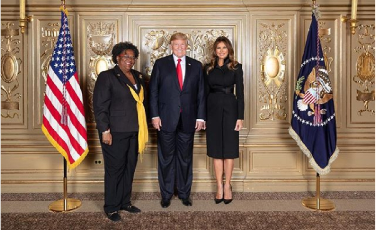 Prime Minister Mia Mottley with US President Donald Trump and First Lady Melania Trump