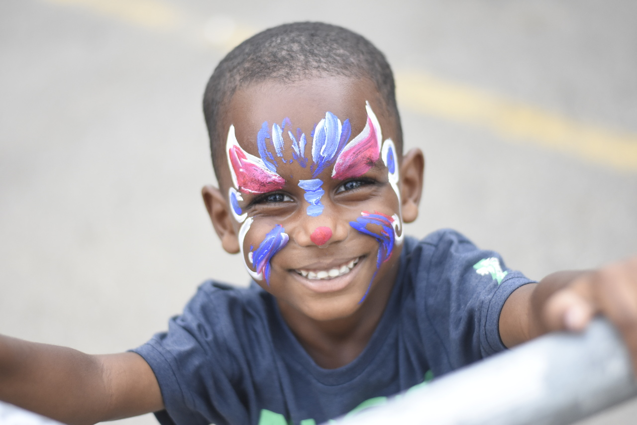 This young boy poses for a photo after getting his face painted. (Photos :Marlon Reid).