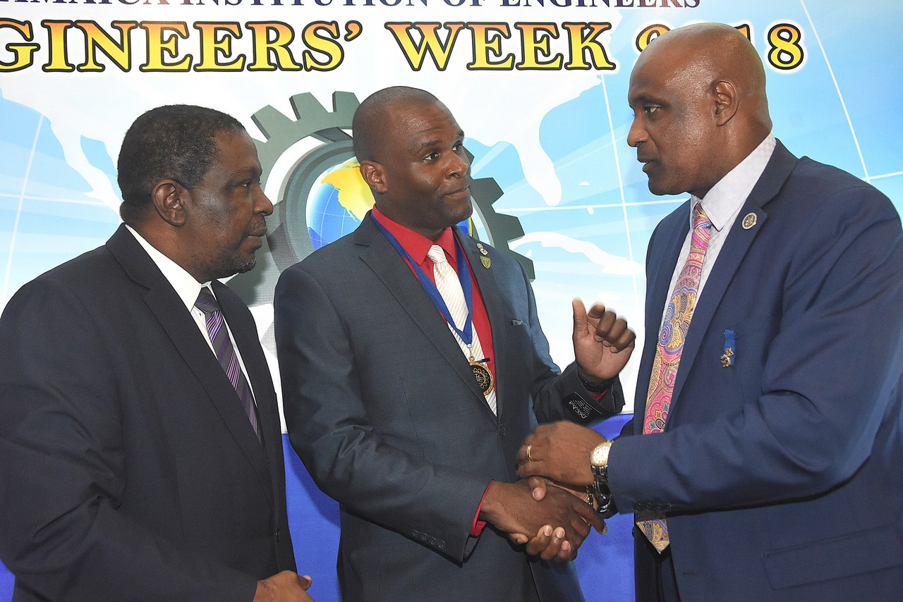Dwight Ricketts (centre), President of the Jamaica Institution of Engineers (JIE), welcomes Professor Fitz Pinnock (right), President of the Caribbean Maritime University to the JIE Engineers Week opening ceremony. At left is Senator Ransford Braham, QC., Chairman of the Urban Development Corporation.