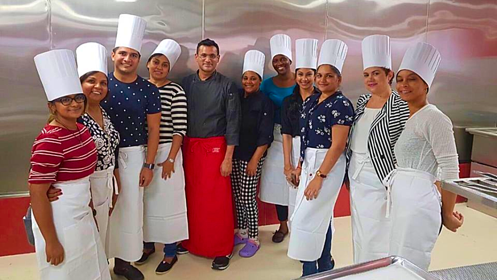 Photo: Culinary students at the Caribbean Culinary Institute pose for a photo with chef and restaurateur, Khalil Ali.