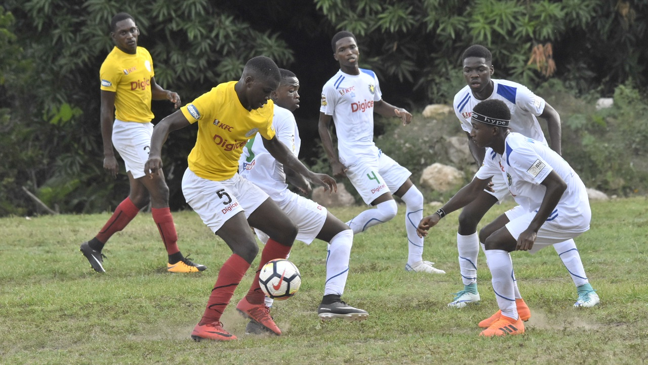 Charlie Smith High (yellow and white) and Meadowbrook High in action on the opening day of the 2018 ISSA/Digicel Manning Cup schoolboy football competition at Chanchery Street, Meadowbrook on Saturday, September 8, 2018. (PHOTOS: Marlon Reid).