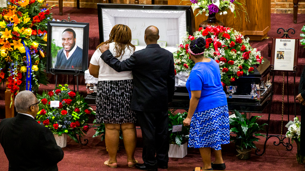 Mourners console each other during the public viewing before the funeral of Botham Shem Jean at the Greenville Avenue Church of Christ on Thursday, September 13, 2018 in Richardson, Texas. (Shaban Athuman/The Dallas Morning News via AP)