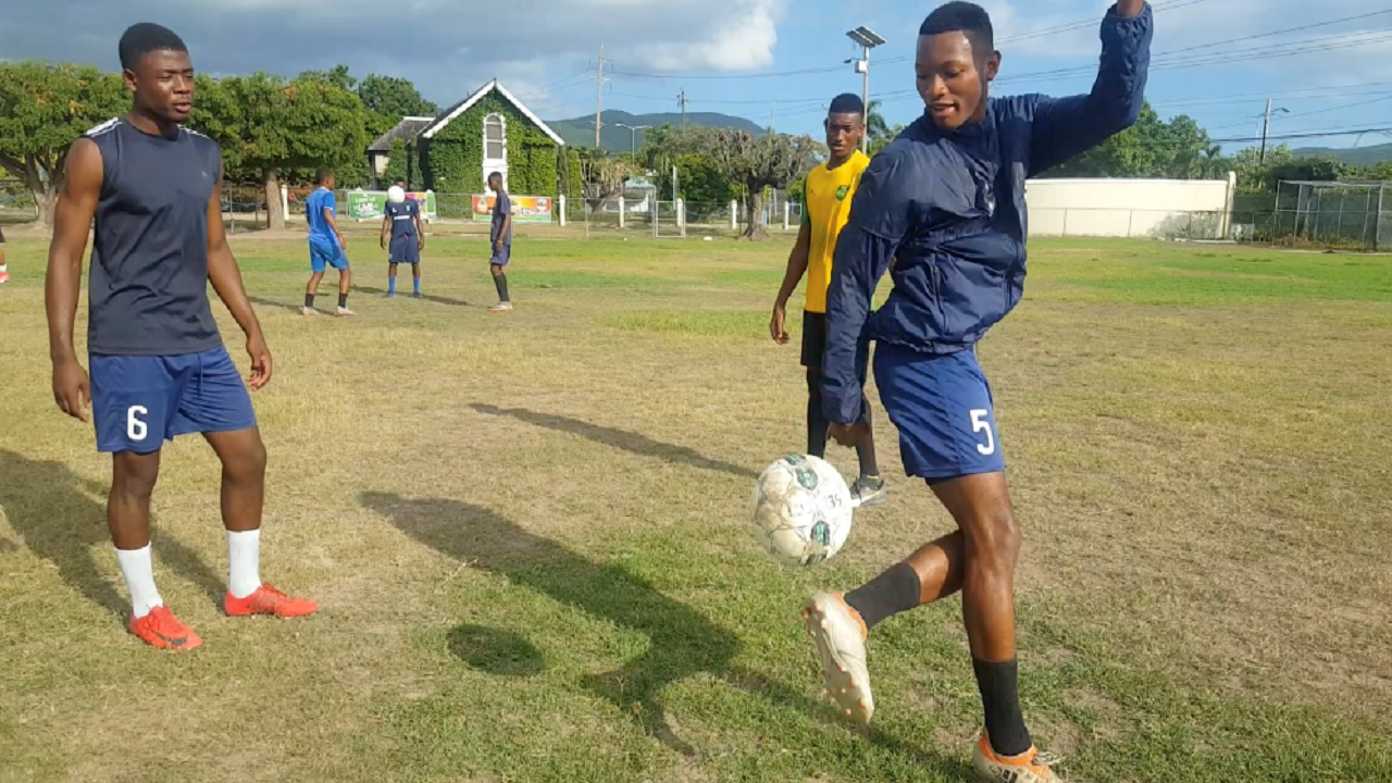 Players from Jamaica College taking part in a recent training session.