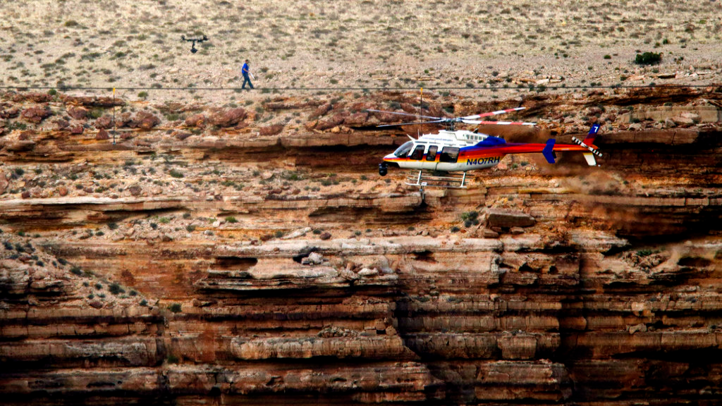 FILE - In this June 23, 2013, file photo, daredevil Nik Wallenda crosses a tightrope 1,500 feet above the Little Colorado River Gorge, Ariz., on the Navajo Nation outside the boundaries of Grand Canyon National Park. (AP Photo/Rick Bowmer, File)