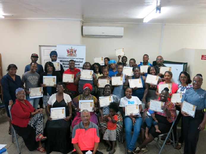 Participants display their certificates following the conclusion of the National Family Service's Division's Parenting Workshop in Point Fortin