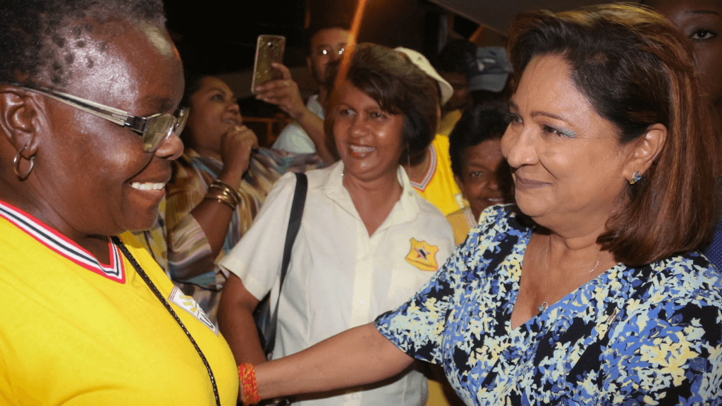 Opposition leader Kamla Persad-Bissessar greets a UNC supporter at the party's Monday Night Forum in Pointe-a-Pierre on September 10, 2018. Photo via Facebook, Kamla Persad-Bissessar.