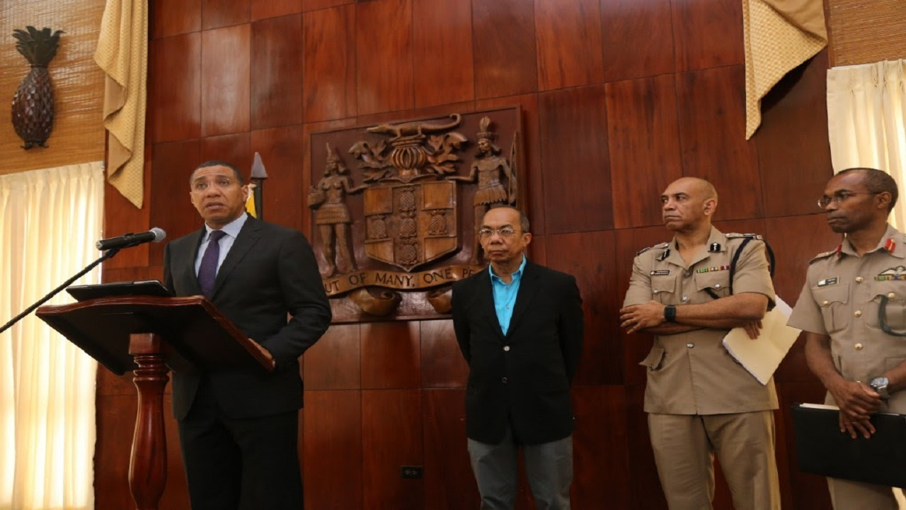 Prime Minister Andrew Holness announces the declaration of a state of public emergency for sections of Kingston and St Andrew. Also pictured (from left) are Dr Horace Chang, Minister of National Security; Major General Antony Anderson, Commissioner of Police; and Major General Rocky Meade, Chief of Defence Staff.