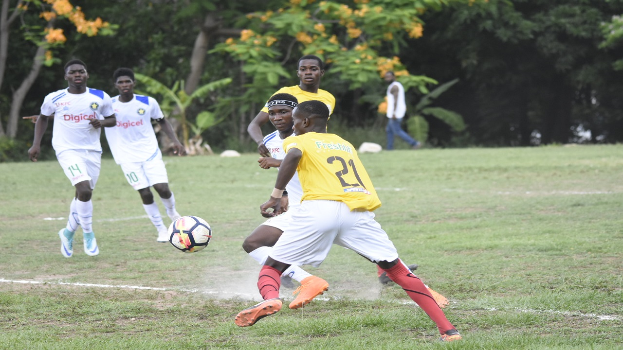 Charlie Smith High (yellow and white) and Meadowbrook High in action on the opening day of the 2018 ISSA/Digicel Manning Cup schoolboy football competition at Chanchery Street, Meadowbrook on Saturday, September 8, 2018. (PHOTO: Marlon Reid).