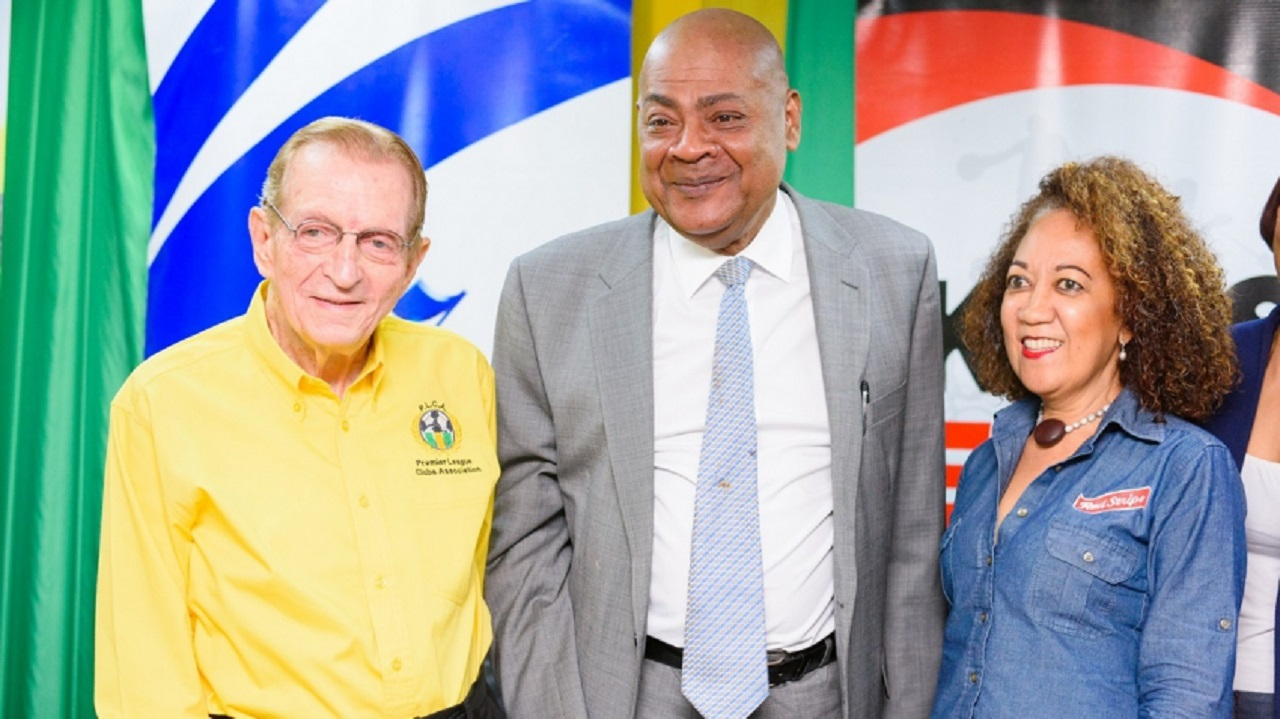 Chairman of the Premier League Clubs Association, Edward Seaga (left),  President of the Jamaica Football Federation (JFF), Michael Ricketts (centre) and Diane Ashton-Smith, Head of Corporate Relations at title sponsors Red Stripe at the launch of the 2018-2019 season of the Red Stripe Premier League on Thursday at the offices of the JFF.