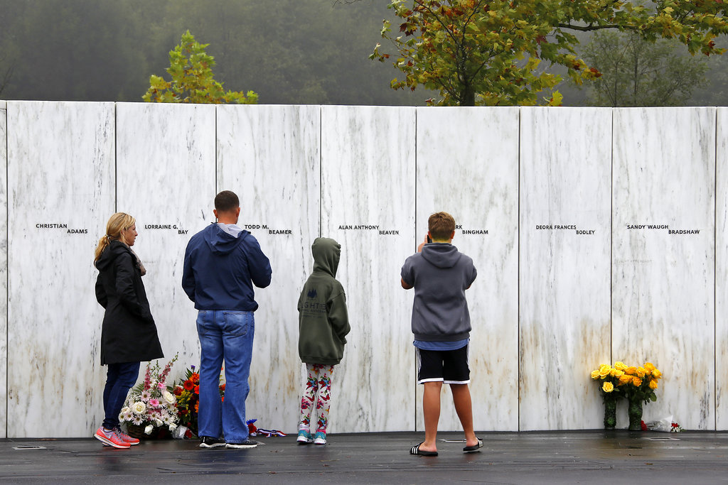 Visitors to the Flight 93 National Memorial in Shanksville, Pa., participate in a sunset memorial service on Monday, Sept. 10, 2018, as the nation marks the 17th anniversary of the Sept. 11, 2001 attacks. (AP Photo/Gene J. Puskar)