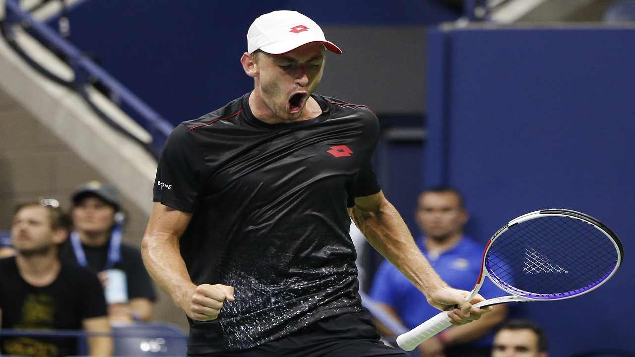 John Millman, of Australia, reacts after winning a point against Roger Federer, of Switzerland, during the fourth round of the U.S. Open tennis tournament, Monday, Sept. 3, 2018, in New York.