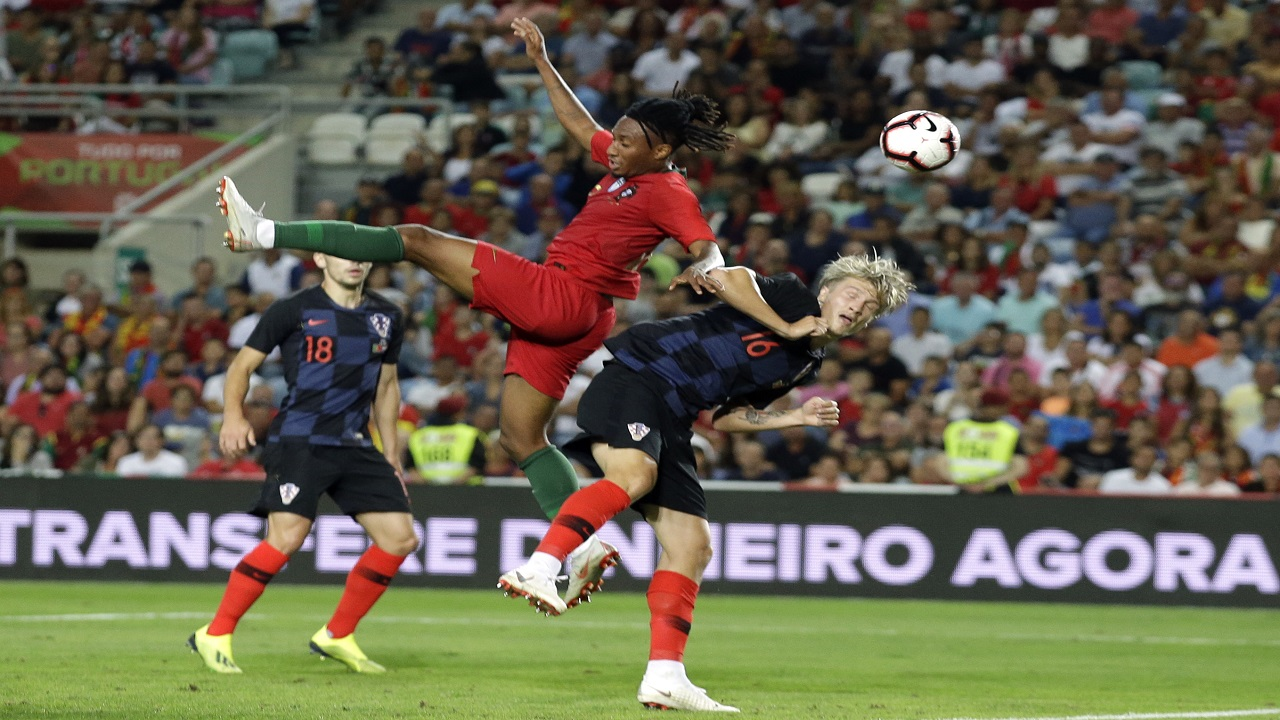 Portugal's Gelson Martins jumps for the ball with Croatia's Tin Jedvaj, right, during their international friendly football match at the Algarve stadium, outside Faro, Portugal, Thursday, Sept. 6, 2018.