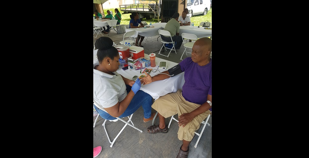 Residents undergoing blood pressure testing courtesy the North-West Regional Health Authority