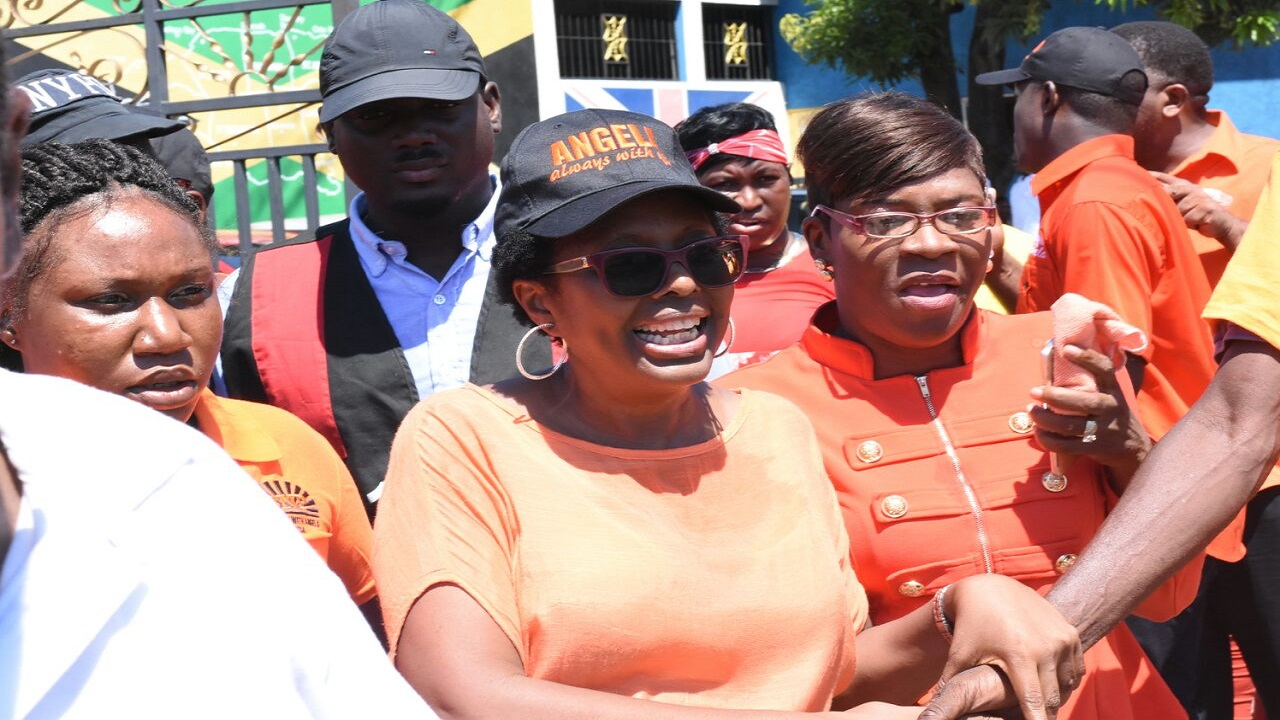 File photo of Angela Brown Burke (centre) and supporters during last year's by-election in South West St Andrew.