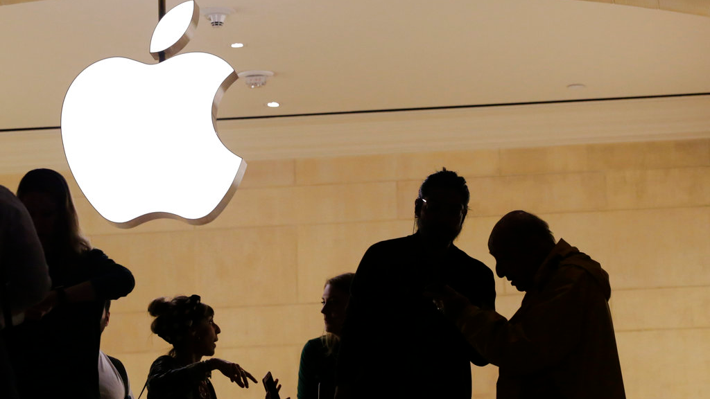In this May 31, 2018, file photo customers enter the Apple store in New York. Apple is expected to unveil its biggest and most expensive iPhone yet on Wednesday, Sept. 12, along with two smaller, cheaper versions in an attempt to widen the product's appeal amid slowing sales growth. (AP Photo/Mark Lennihan, File)