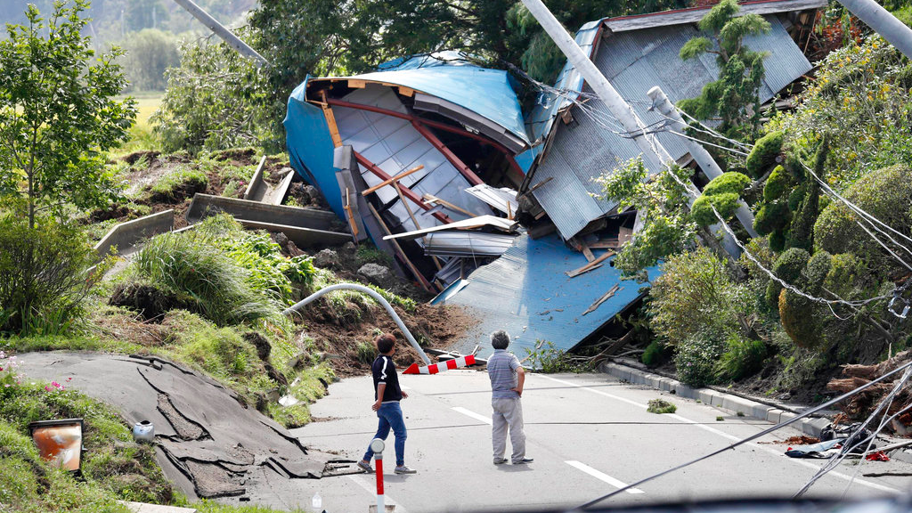 Buildings destroyed by a landslide block a road after an earthquake in Atsuma town, Hokkaido, northern Japan, Thursday, Sept. 6, 2018. Several people were reported missing in the nearby the town, where a massive landslide engulfed homes in an avalanche of soil, rocks and timber. (Masanori Takei/Kyodo News via AP)