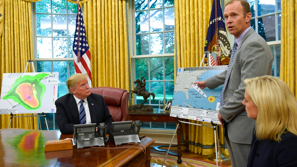 President Donald Trump, left, listens as FEMA Administrator Brock Long, center, talks about Hurricane Florence in the Oval Office of the White House in Washington, Tuesday, Sept. 11, 2018, with Homeland Security Secretary Kirstjen Nielsen, right. (AP Photo/Susan Walsh)