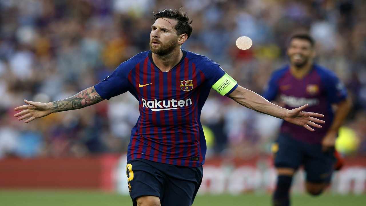 Barcelona forward Lionel Messi celebrates after scoring the opening goal for his team during the group B Champions League football match against  PSV Eindhoven at the Camp Nou stadium in Barcelona, Spain, Tuesday, Sept. 18, 2018.