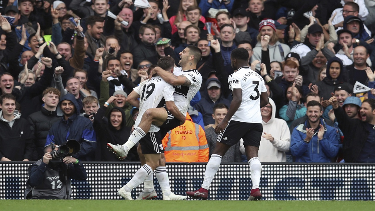Fulham's Aleksandar Mitrovic, centre, celebrates scoring against Watford during their English Premier League football match at Craven Cottage in London, Saturday Sept. 22, 2018.
