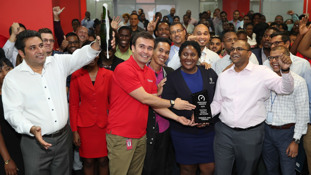 Jabbor Kayumov, Digicel CEO (2nd from left) celebrates with Digicel staff after winning the Ookla award