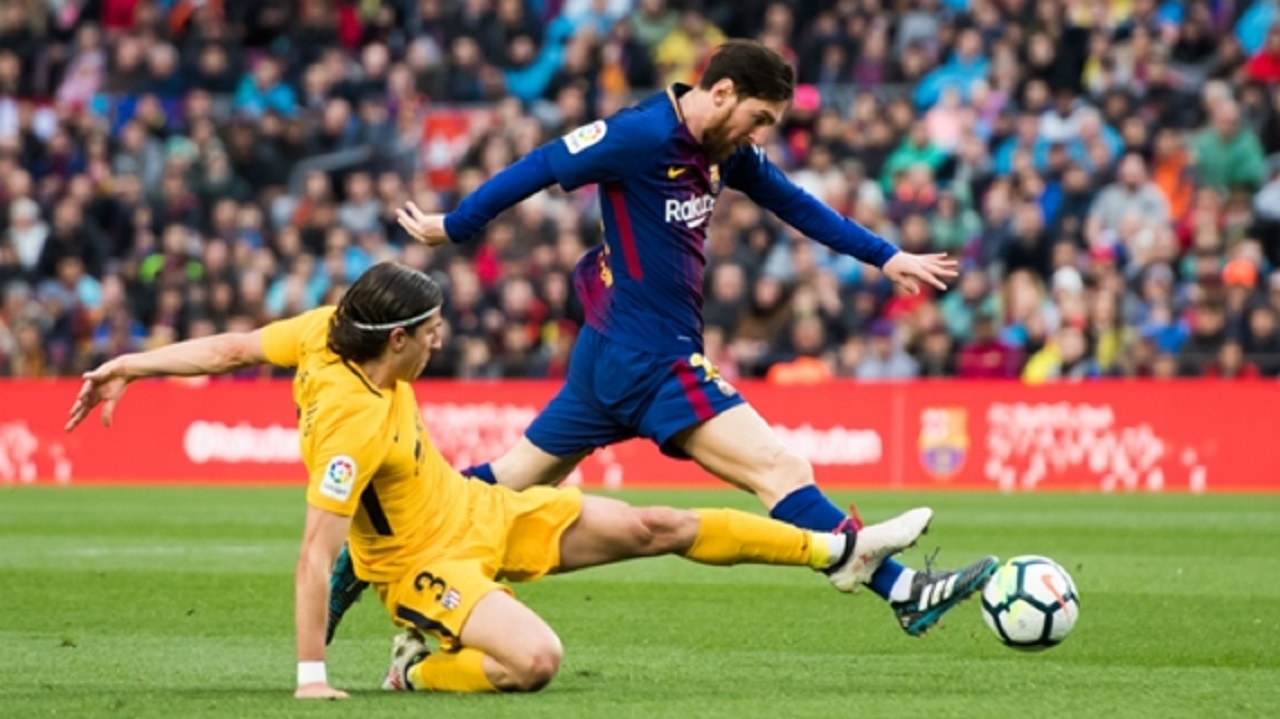 Filipe Luis challenges Lionel Messi.