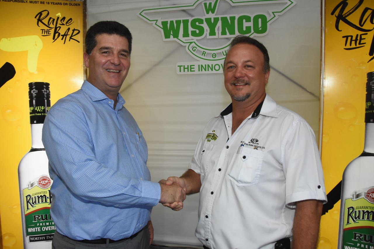 Co-Managing Director of Worthy Park Estate Limited Gordon Clarke (right) and Chairman of Wisynco Group Limited William Mahfood (left), shake on a deal well tailored for both entities to enter an exclusive five-year distribution agreement.