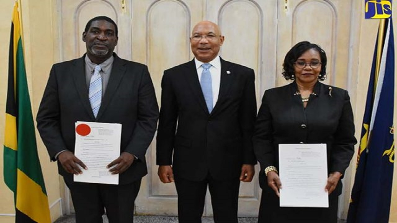 Governor General, Sir Patrick Allen (centre), with judges who have been promoted, after a swearing-in ceremony at King's House on Monday. At left is Justice Leighton Pusey, who has been appointed to act as Judge of the Court of Appeal, and also puctured is Pamela Mason, who will act as Master-in-Chambers of the Supreme Court.