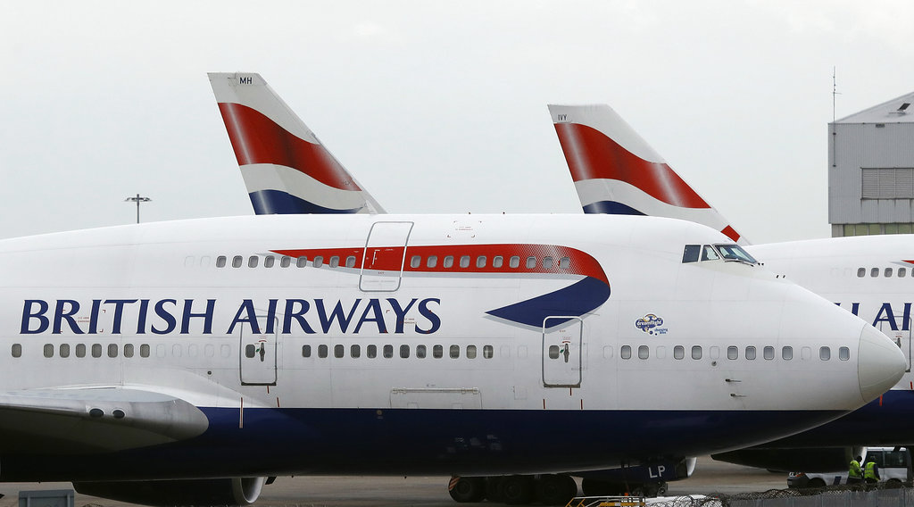 FILE - In this file photo dated Tuesday, Jan. 10, 2017, British Airways planes are parked at Heathrow Airport in London.  British Airways announced a