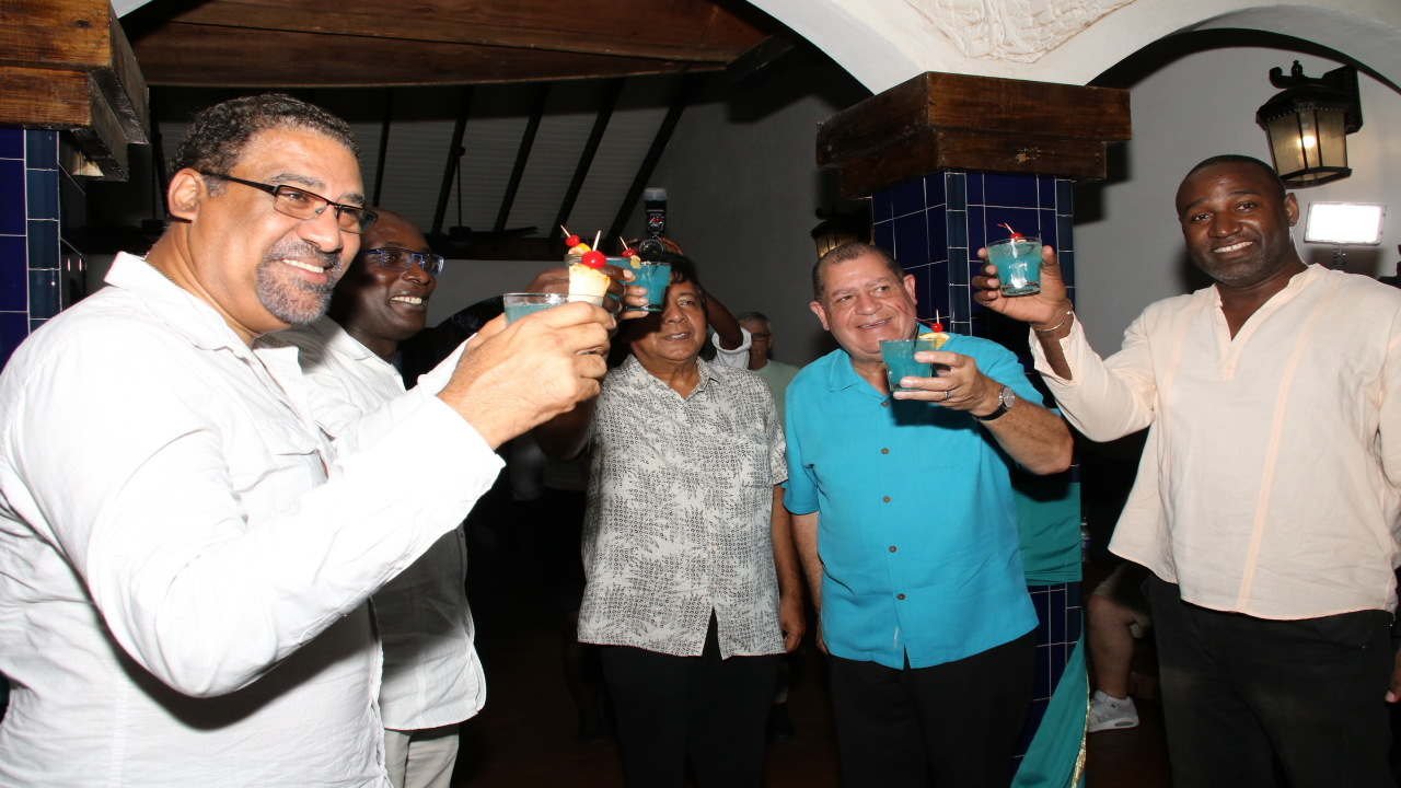 Puerto Seco Beach's principal, Kenny Benjamin (centre) shares in a toast with some of the guests at Saturday's official opening of the new beach complex in Discovery Bay, St Ann.  Also pictured (l-r) are politicians Wykeham McNeill, Ruel Reid, Audley Shaw and Dayton Campbell.