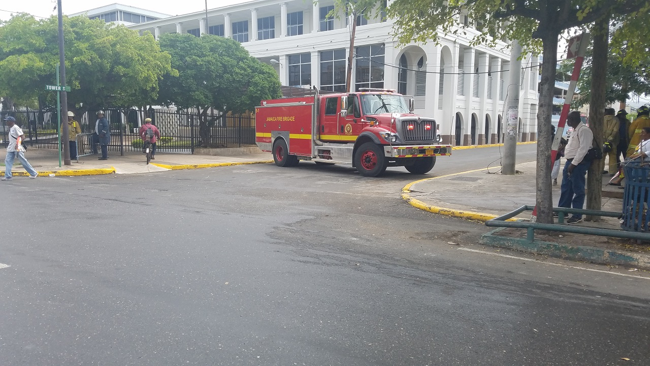 A Jamaica Fire Brigade truck  is parked outside the Supreme Court in downtown Kingston on Monday following a bomb threat at the facility.