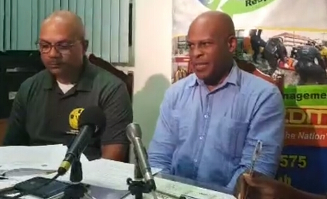 Captain Robert Harewood, Deputy Director at the Department of Emergency Management and Minister Edmund Hinkson, Acting Attorney General at press conference tonight.