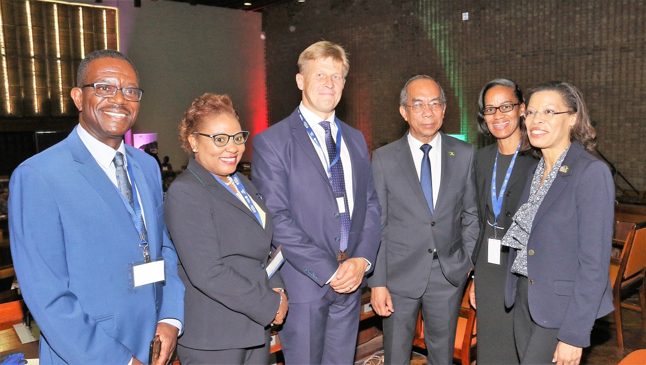 Minister of National Security, Dr Horace Chang (third) right, is flocked by (from left) Dr Noel Watson, Chairman, ProTrain, Gail Abrahams, CEO, AMCHAM Jamaica, Fredrik Ekfeldt, Minister Counsellor/Head of Political, Press and Information Section, European Union, Wahkeen Murray, Actg. Permanent Secretary, Ministry of Science, Energy and Technology and Allison Peart, President, AMCHAM Jamaica.