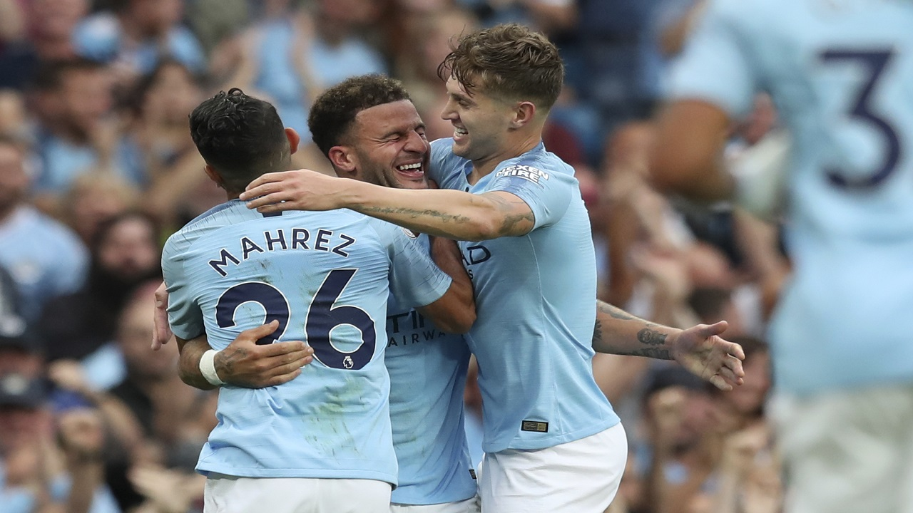 Manchester City's Kyle Walker celebrates with Riyad Mahrez, left, and John Stones, right, after scoring his side's second goal during the English Premier League football match against Newcastle United at the Etihad Stadium in Manchester, England, Saturday, Sept. 1, 2018.