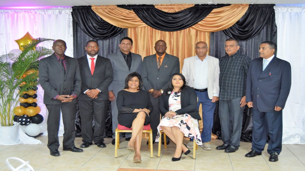 Minister of Trade and Industry Senator the Honourable Paula Gopee-Scoon (seated) with members of the new Gasparillo Chamber of Commerce. Photo courtesy The Ministry of Trade and Industry