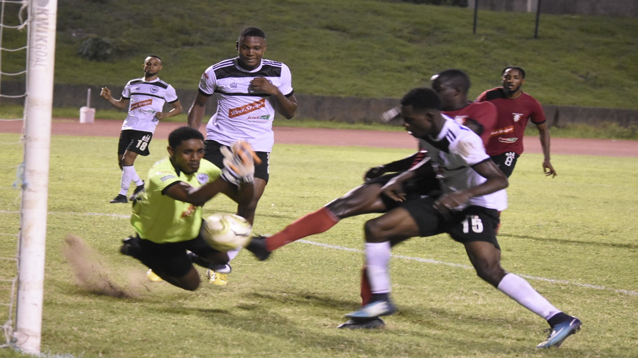 Action from the Red Stripe Premier League game between Cavalier and Arnett Gardens at the Stadium East field on Sunday, September 23, 2018. Cavalier, in white top, won the game 2-1. (PHOTOS: Marlon Reid).