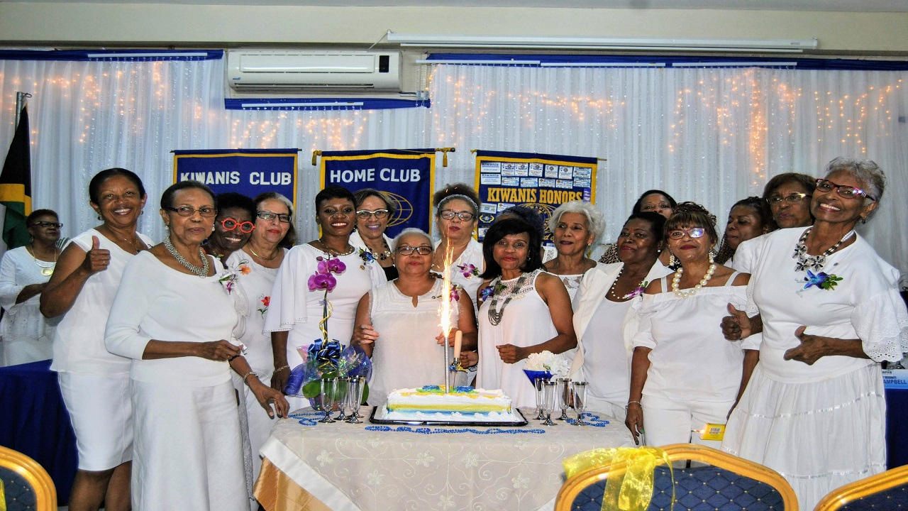 Some of the Club Presidents and Secretaries over the 29 years cutting the Anniversary cake.