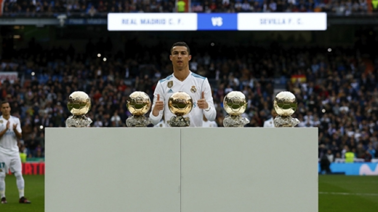 Cristiano Ronaldo with his Ballon d'Or trophies.