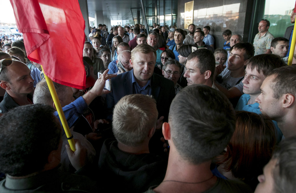 Andrei Ishchenko, communist candidate of governor election in Primorye region, center, speaks with his supporters in Vladivostok, Russia's Far East, Monday, Sept. 17, 2018. (AP Photo/Alexander Khitrov)